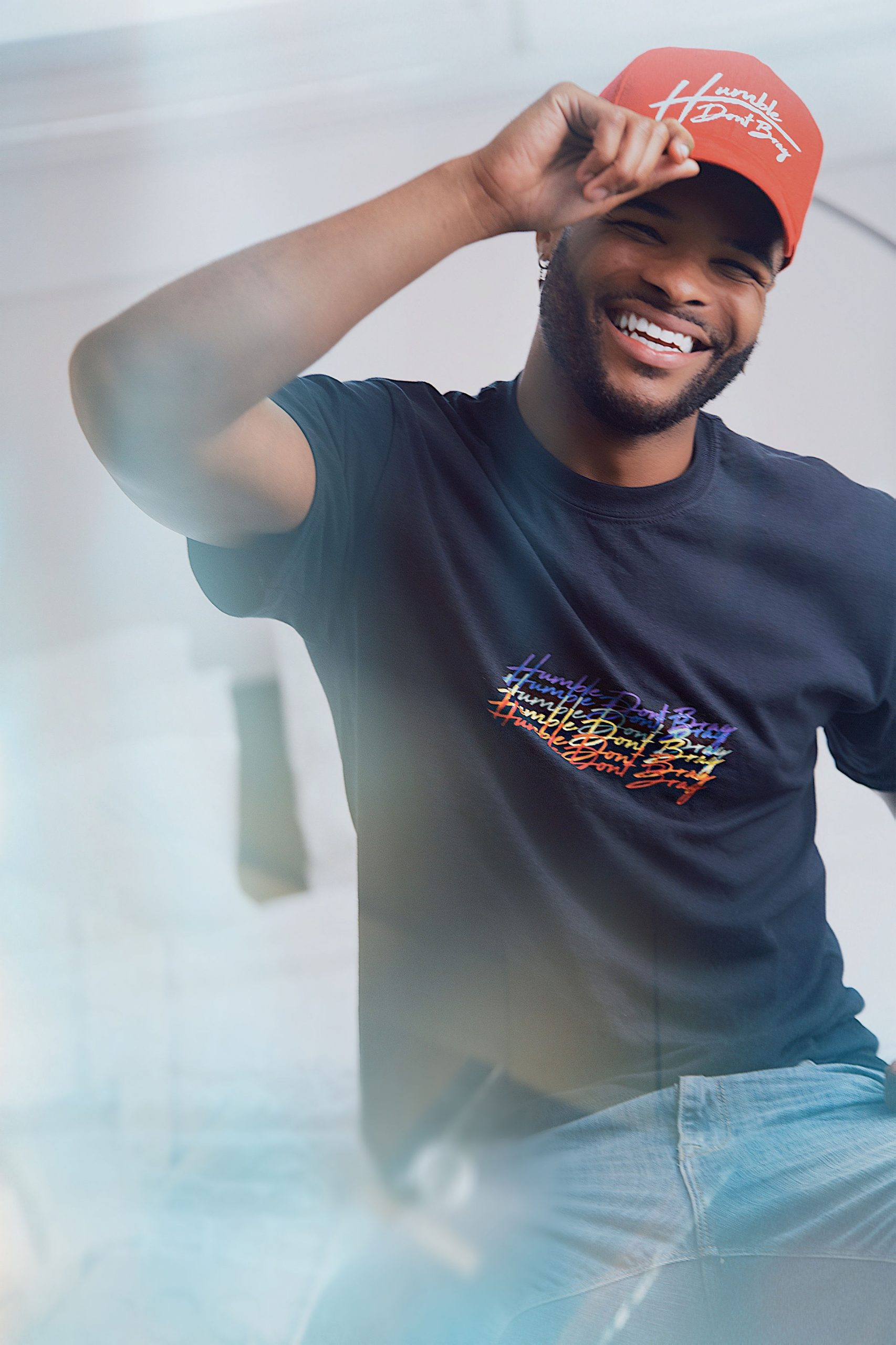 black tshirt with cascading logo in traditional rainbow colors
